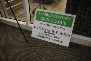 A sign inside the entranceway of the Lambert's Point Community Center to notifies community members of their league's monthly meetings.