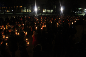 The ODU community gathers in front of Kaufman Mall to pay their respects by lighting candles in memory.